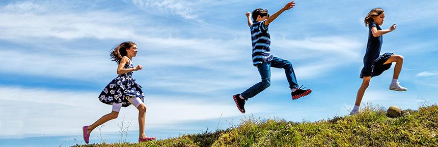 children running and skipping outside