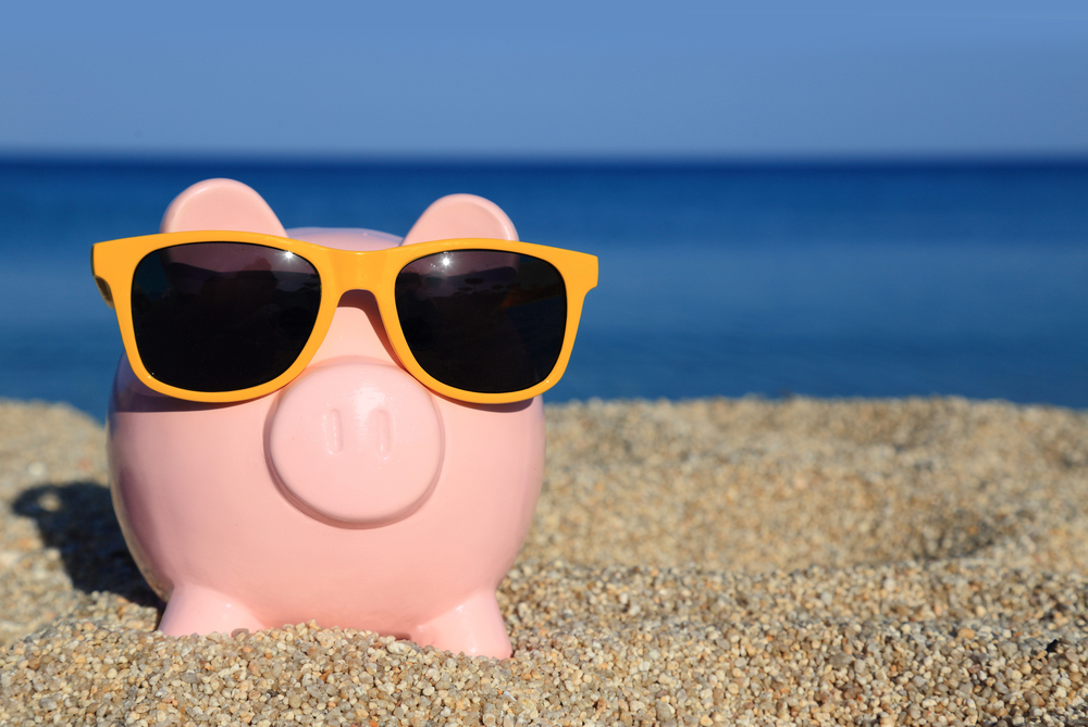 piggy bank wearing sun glasses